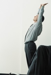 Businessman Stretching at Work
